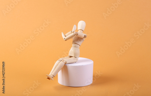 The puppet sits on the podium. Beige background Poster Mural XXL