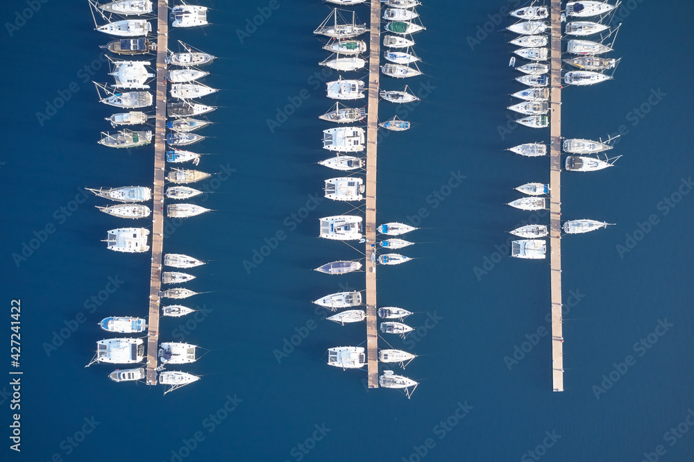 Top view of boats on blue water surface.
