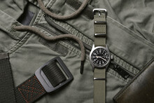 Vintage Military Watch With Nato Strap And Tactical Belt On Army Green Background, Classic Timepiece Mechanical Wristwatch, Military Men Fashion And Accessories.