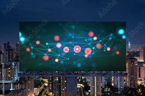 Tela Information flow hologram on road billboard, night panorama city view of Kuala Lumpur