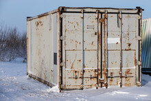 Rusty Gray Cargo Container Stands On Snow