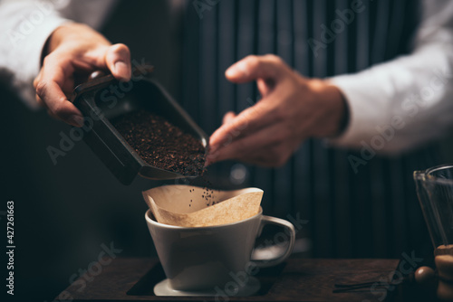 Fotografiet professional barista making coffee at cafes in the morning, hot drink espresso i