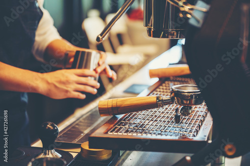 Fototapeta barista person making coffee in cafe, hot drink cup from espresso machine, bever