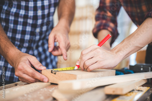 Obraz professional carpenters woodworking team work together creatively, creative carpenter working workshop for wooden craftman with wood - fototapety do salonu