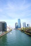 Osaka skyline along with Neya river (Neyagawa) in Japan . Panoramic view. - 寝屋川と大阪のビル群 水上バス 日本