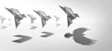 Ambitious Leadership And Leader Vision Or Leading Ambition As A Business Symbol For Innovative Imagination And Success Metaphor As An Origami Paper Bird Casting A Shadow Of Powerful Real Wings