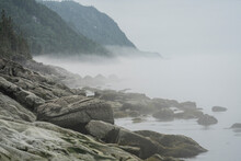 Early Morning Fog Along The Rocky Shoreline Of The St. Lawrence River