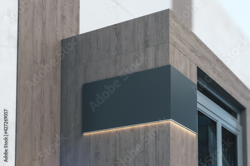 Fotografering Black signboard with copyspace and backlight on the corner of eco style wooden b