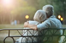 Senior Couple On Bench In The City Park