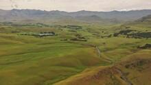 Wide Umgeni Valley Nature Reserve Green Landscape Crossed By Winding River - Aerial Slide Shot