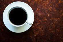 A Cup Of Coffee On A Wooden Table. Morning Coffee.