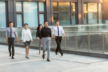 Confident Business People Walking Outdoors