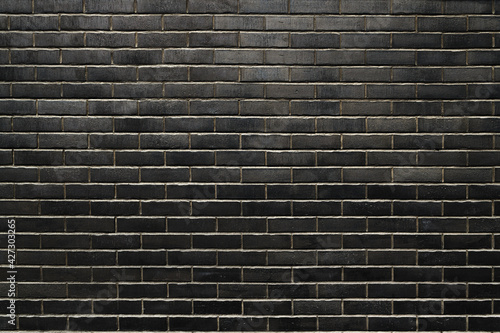 Black brick wall texture as background Fototapete