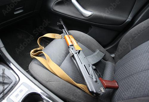 Obraz na plátně Kalashnikov assault rifle in the passenger seat of the car