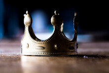 Toy Plastic Crown In Bad Shape. Corruption, Power Struggle, Worn Out Monarchies.
