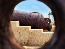 Close Up View To The Old Powder Cannon Through The Hole. Zanzibar, Tanzania.