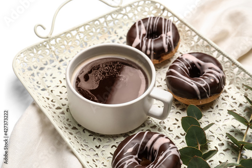 Fototapeta Tray with cup of coffee and donuts, closeup