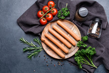 Plate With Tasty Sausages, Tomatoes And Herbs On Dark Background