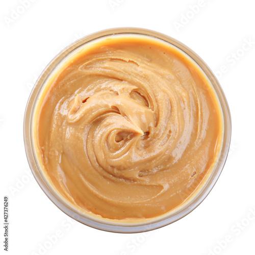 Fototapeta Delicious peanut butter in bowl isolated on white, top view obraz na płótnie