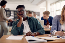 Black Male Student Feeling Bored During Class At The University.