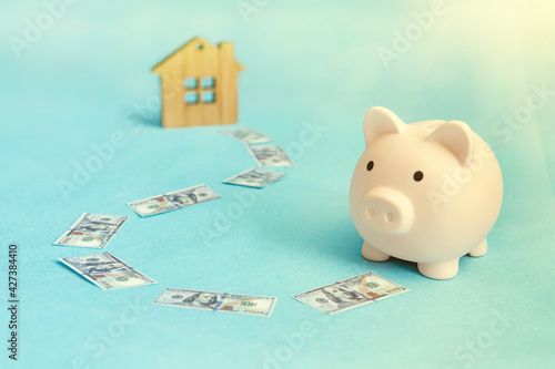 Fototapeta concept of saving money to buy an apartment, house or other residential property