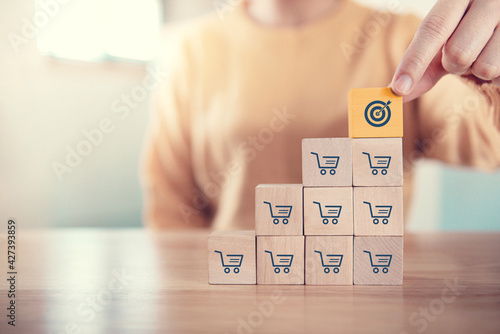 Sale volume increase make business success, Wood cube with icon goal and shopping cart symbol Fototapet