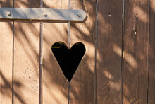Heart In Wooden Door In Outhouse Toilet
