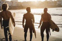 Multi Generational Surfer Men Having Fun On The Beach - Multiracial People, Lifestyle And Sport Concept - Focus On Senior Head