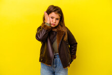 Little Caucasian Girl Isolated On Yellow Background Tired And Very Sleepy Keeping Hand On Head.