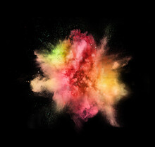Explosion Of Colored, Fluid And Neoned Powder On Black Studio Background With Copyspace