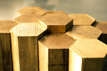 Hexagon Made Of Brass Sawn Into Blanks For Further Processing On A Metalworking Machine. Metal Cutting In Production.