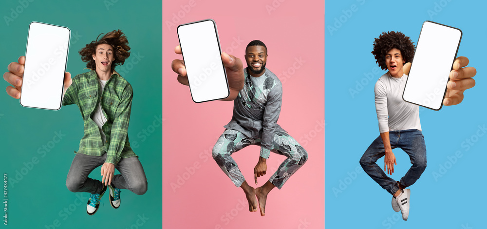 Leinwandbild Motiv - Prostock-studio : Cool young guys with empty smartphones jumping up in air over colorful studio backgrounds, mobile application mockup