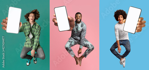 canvas print motiv - Prostock-studio : Cool young guys with empty smartphones jumping up in air over colorful studio backgrounds, mobile application mockup