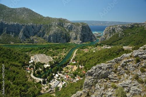 Cetina River entering Adriatic Sea at Omis through a gate of Damlatian Moutains in Omis, Dalmatia, Croatia