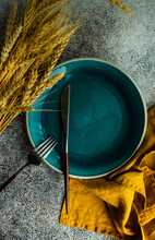 Autumnal Place Setting With Ears Of Wheat On A Table