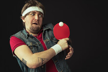 Young Caucasian Funny Man Playing Ping Pong Isolated On Black Background.