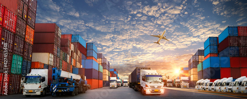 Fotografia, Obraz Container truck in ship port for business Logistics and transportation of Contai