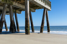 Large Concrete Pier Seen From Beneath, Blue Sky And Calm Ocean Waters, Tybee Island Georgia, Horizontal Aspect