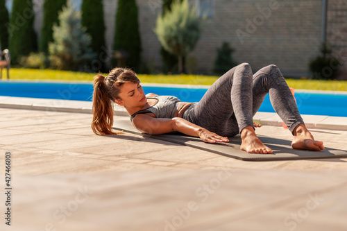 Woman doing sit ups while working out