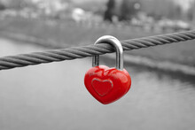 Old Red Heart Shaped Lock On Wire Rope. Love Lock On The Bridge.