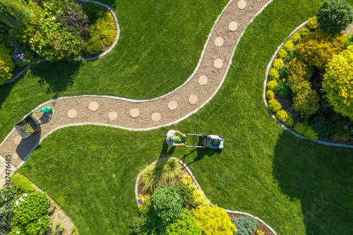 Big Garden Grass Field Mowing by Caucasian Gardener
