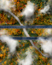 Aerial View Of The Clouds Settling Down To Bring Rain On The New England Fall Colors At Connecticut, USA