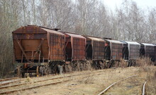 Freight Train At An Old Abandoned Station
