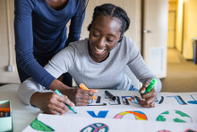 Happy Teen Activists Coloring Environmental Poster Together