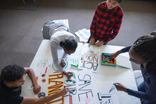 Teen Activists Making Environmental Posters In Community Center