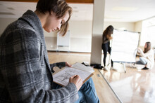 High School Girl Student Sketching In Classroom