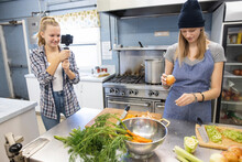 Teen Girls Vlogging Cooking Class In Community Center Kitchen
