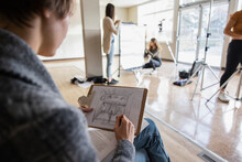 High School Girl Student Sketching Stage Set In Drama Classroom