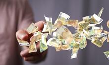 Euro Bills Flying Around  In Hand