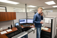 Man Talking On Phone In Office Cubicle